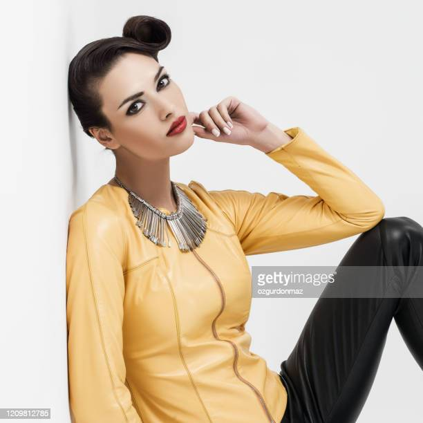 beautiful young woman posing in leather - up do stock pictures, royalty-free photos & images