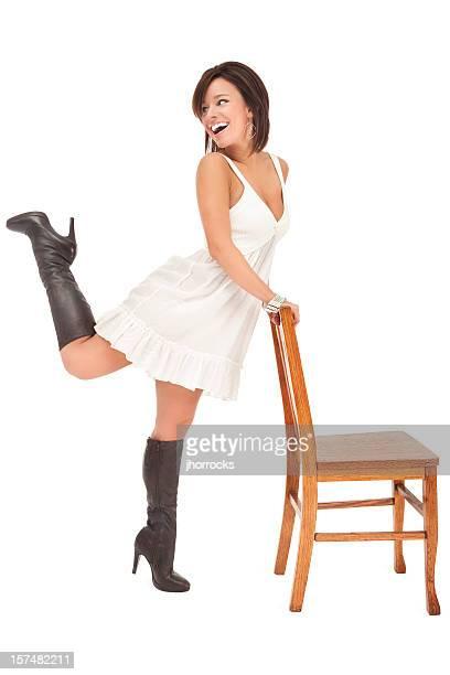 beautiful young woman posing with chair - laars stockfoto's en -beelden