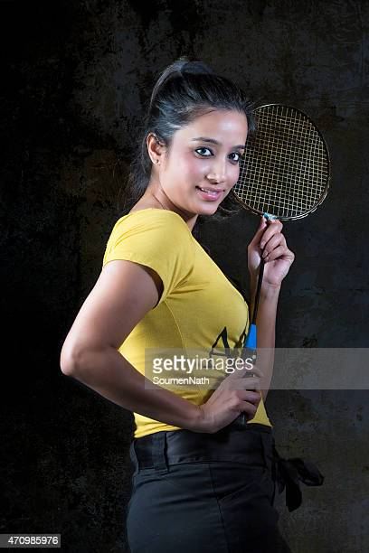 Beautiful young woman posing with Tennis Racket