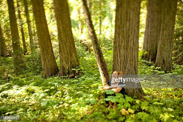 Beautiful young woman relaxing and appreciating nature