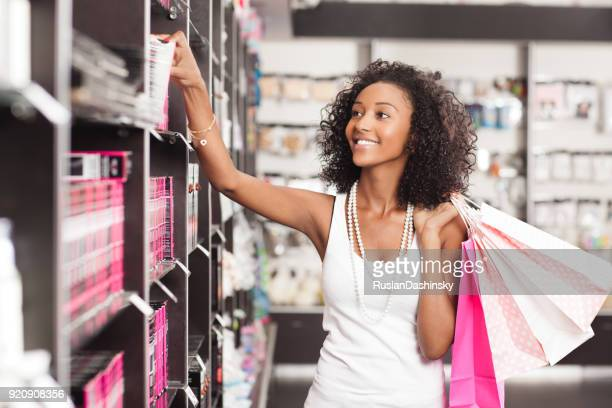 beautiful young woman shopping cosmetics. - beautiful israeli women stock pictures, royalty-free photos & images