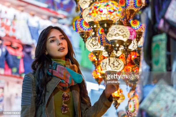 Beautiful young woman shopping in Grand Bazaar, Istanbul, Turkey