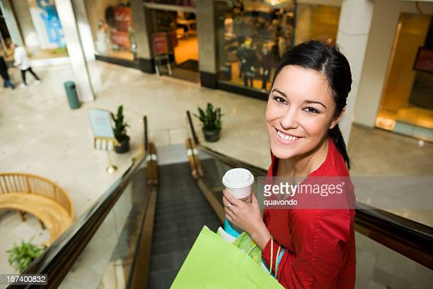 Beautiful Young Woman Shopping in Mall at Christmas, Copy Space