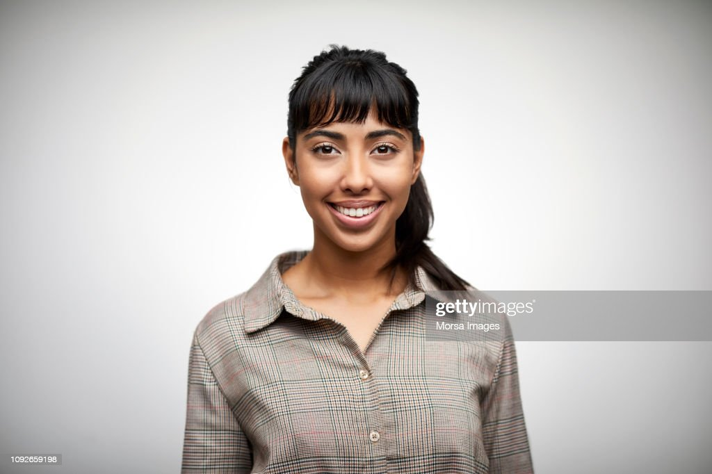 Beautiful young woman smiling on white background : Stock-Foto