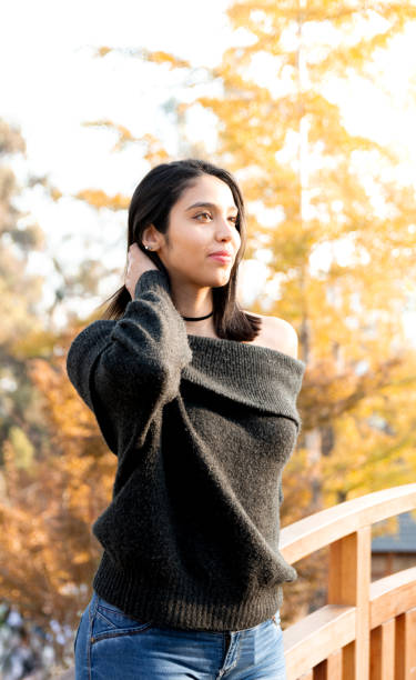 Beautiful Young Woman Standing In Park During Autumn