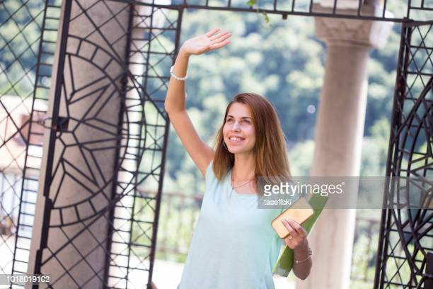 Beautiful  young woman student walking in daytime european city