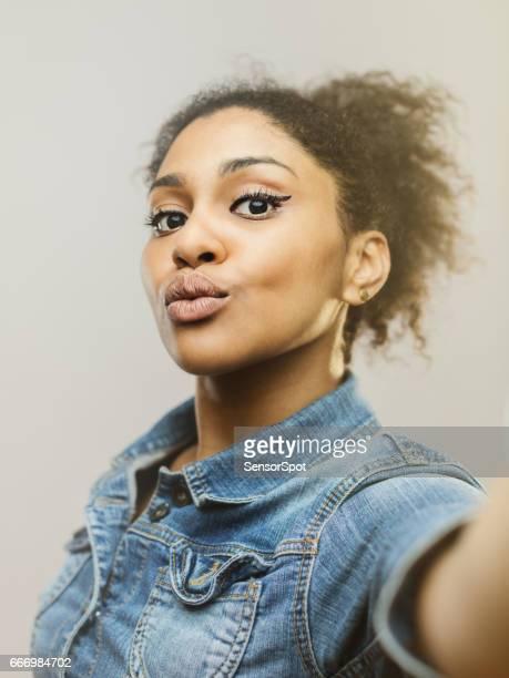 beautiful young woman taking a selfie - vertical imagens e fotografias de stock