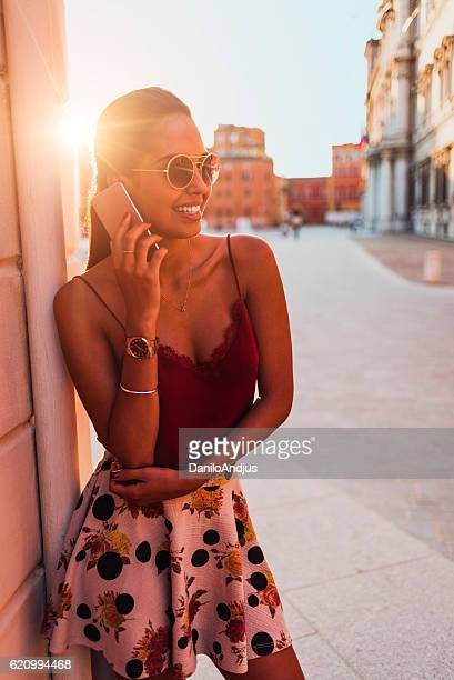 beautiful young woman talking on her smart phone