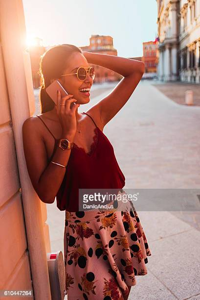 beautiful young woman talking on her smartphone