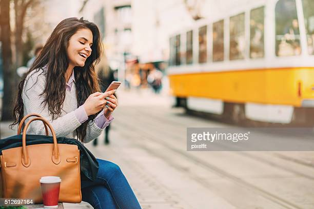 Beautiful young woman texting