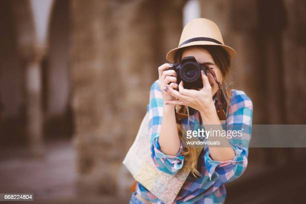 beautiful young woman tourist with camera and map - pointing at camera stock photos and pictures