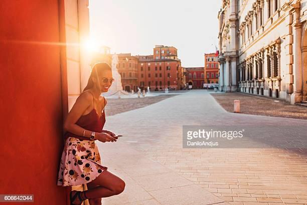 beautiful young woman using her smart phone