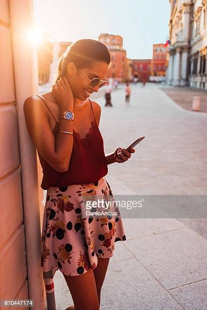 beautiful young woman using her smartphone