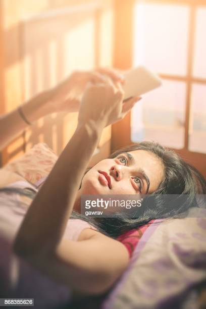 Beautiful young woman using mobile phone.