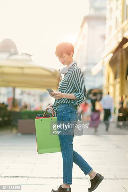 Beautiful Young Woman Using Smart Phone In The City