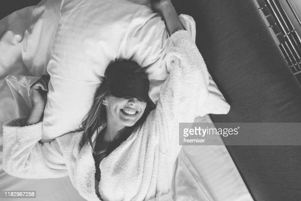 beautiful young woman waking up - bathrobe stock pictures, royalty-free photos & images