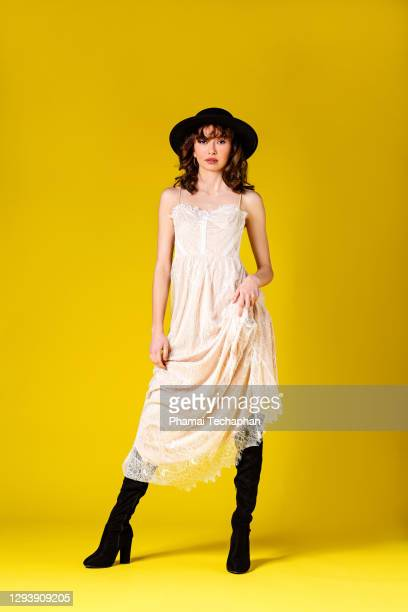 beautiful young woman wearing black hat - ankle boot stock pictures, royalty-free photos & images