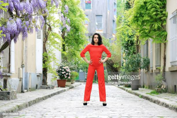 beautiful young woman wearing red suit in a paved street of paris, during springtime. 13 april 2017 - multi colored suit stock photos and pictures