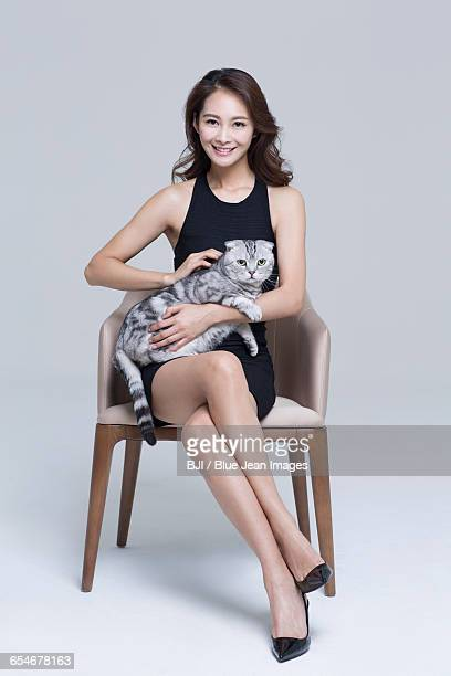 Beautiful young woman with a cat