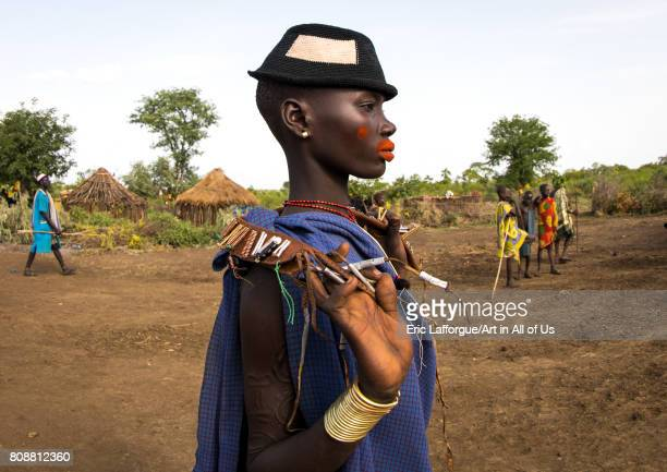 Beautiful young woman with a hat and some make up during the fat men ceremony in the Bodi tribe Omo valley Hana Mursi Ethiopia on June 4 2017 in Hana...