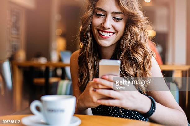 Beautiful young woman with a mobile phone