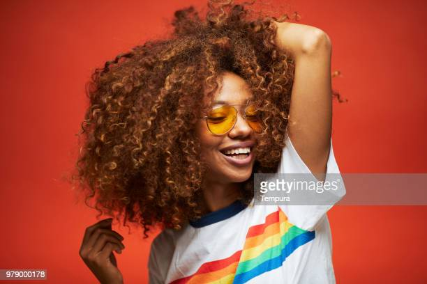 beautiful young woman with afro, reggaeton musician. - gay rights stock pictures, royalty-free photos & images