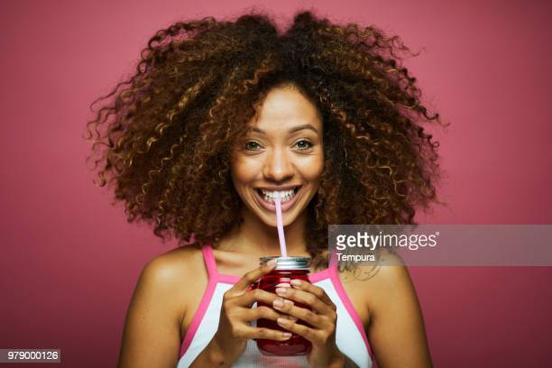 beautiful young woman with afro, summer time. - drinking straw stock pictures, royalty-free photos & images