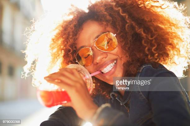Beautiful young woman with afro, summer time.