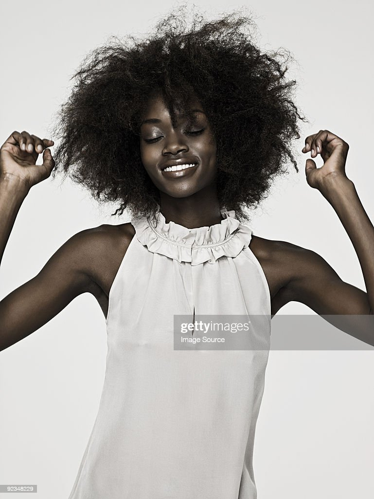 Beautiful young woman with an afro : Stock Photo