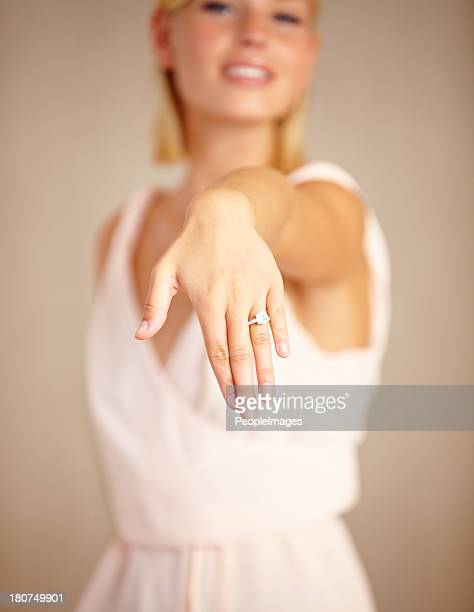 she's pleased about his proposal - showing off stock pictures, royalty-free photos & images