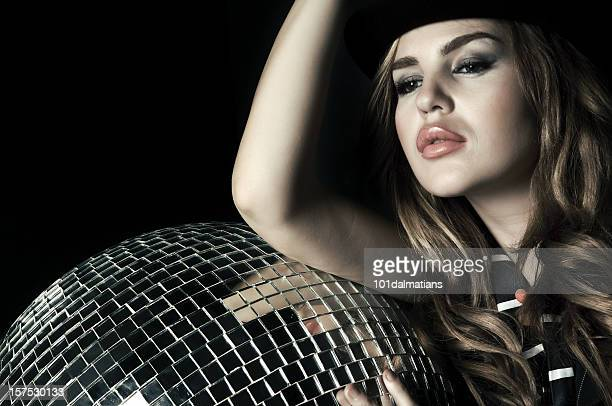 Beautiful young woman with black hat