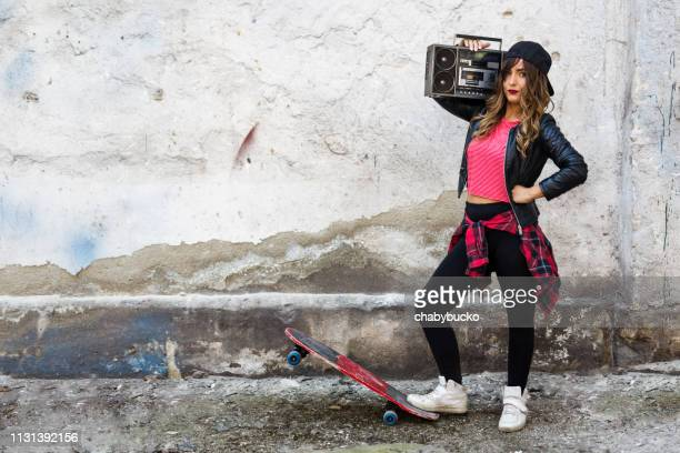 Beautiful young woman with boom box