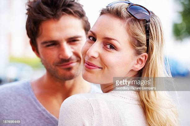 Beautiful young woman with boyfriend, smiling