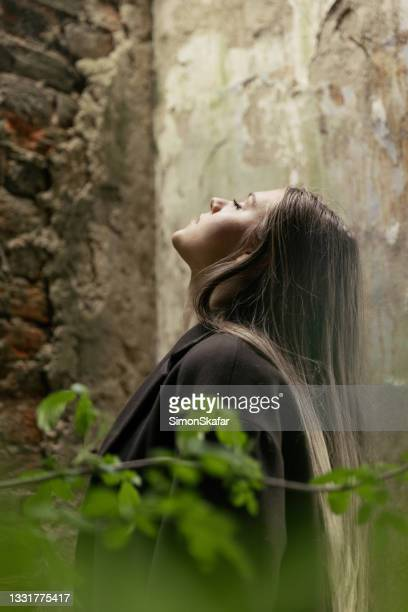beautiful young woman with closed eyes - moment of silence stock pictures, royalty-free photos & images