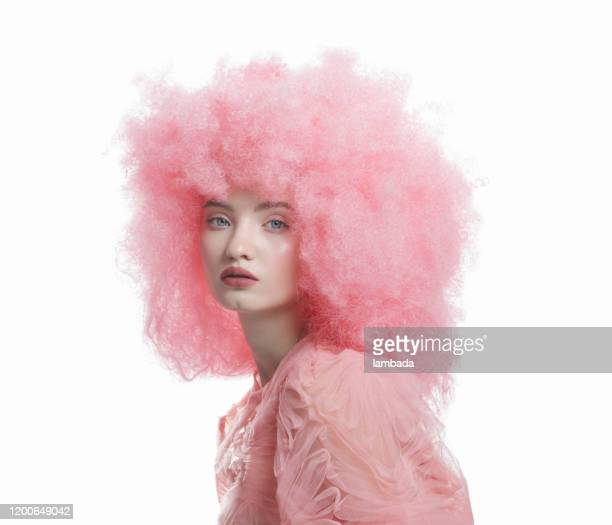 beautiful young woman with curly pink hair - eccentric stock pictures, royalty-free photos & images