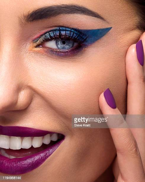 beautiful young woman with full make up touching face - eye liner stock pictures, royalty-free photos & images