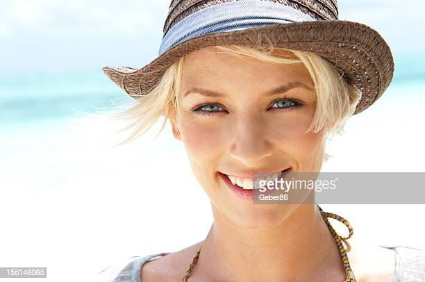 beautiful young woman with hat - toothy smile stock photos and pictures