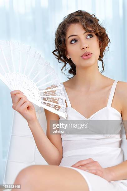 Beautiful young woman with lace fan
