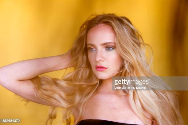 A beautiful young woman with long blond hair.