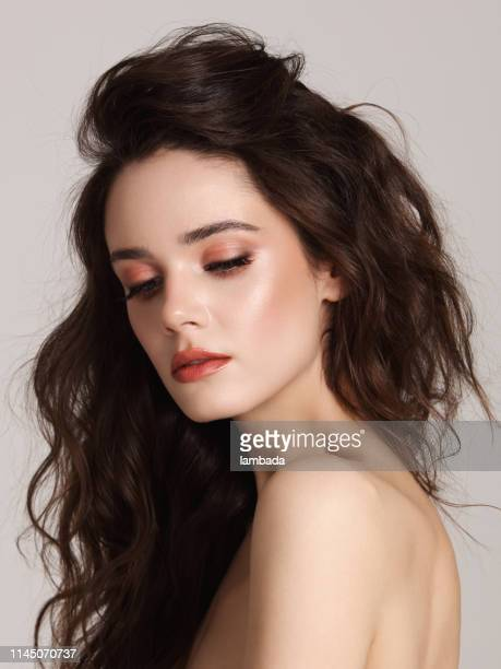 beautiful young woman with long hair - wavy hair stock pictures, royalty-free photos & images