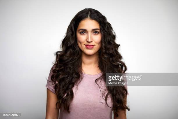 beautiful young woman with long wavy hair - women fotografías e imágenes de stock