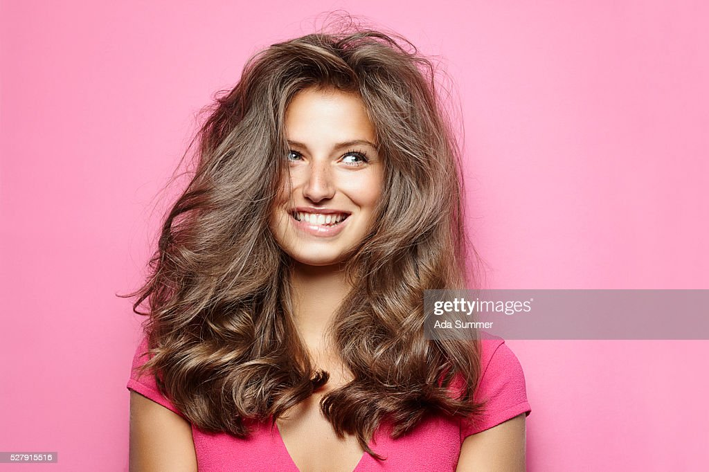 Beautiful young woman with messy hair : Stock Photo