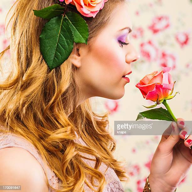 Beautiful young woman with roses in her hair
