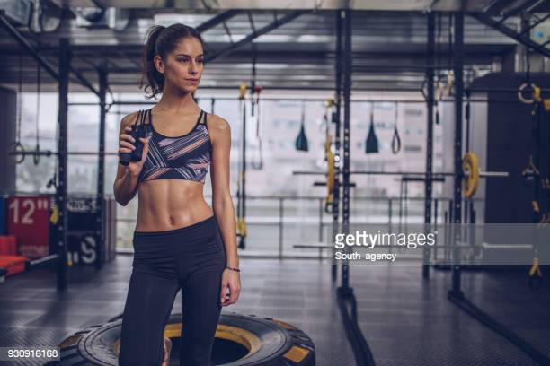 beautiful young woman with skipping rope - asian six pack stock photos and pictures