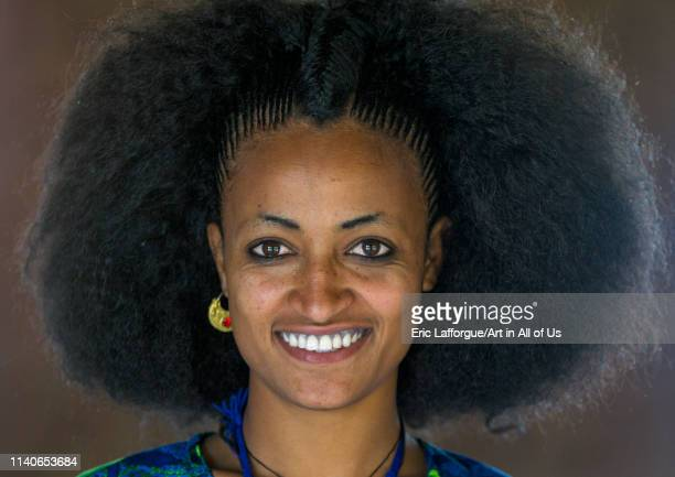 Beautiful young woman with traditional hairstyle, Lalibela, Ethiopia on January 19, 2014 in Lalibela, Ethiopia.