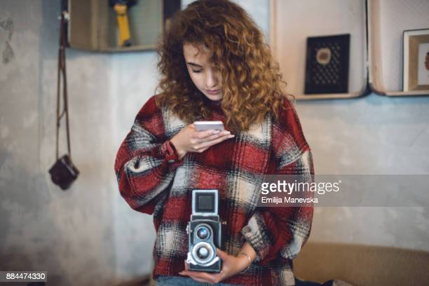 Beautiful young woman with vintage camera