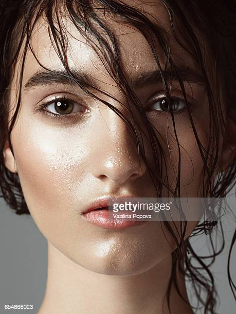 beautiful young woman with wet hairstyle - nass stock-fotos und bilder