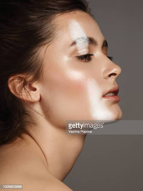 beautiful young woman with white strip make-up - aspecto da epiderme - fotografias e filmes do acervo