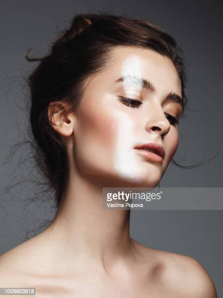 beautiful young woman with white strip make-up - beauty stock pictures, royalty-free photos & images