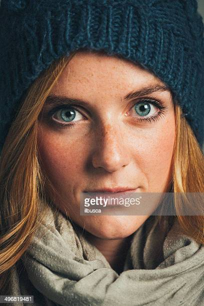 Beautiful young woman with winter hat and scarf